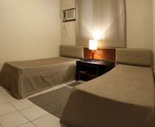 quarto de solteiro com duas camas 5